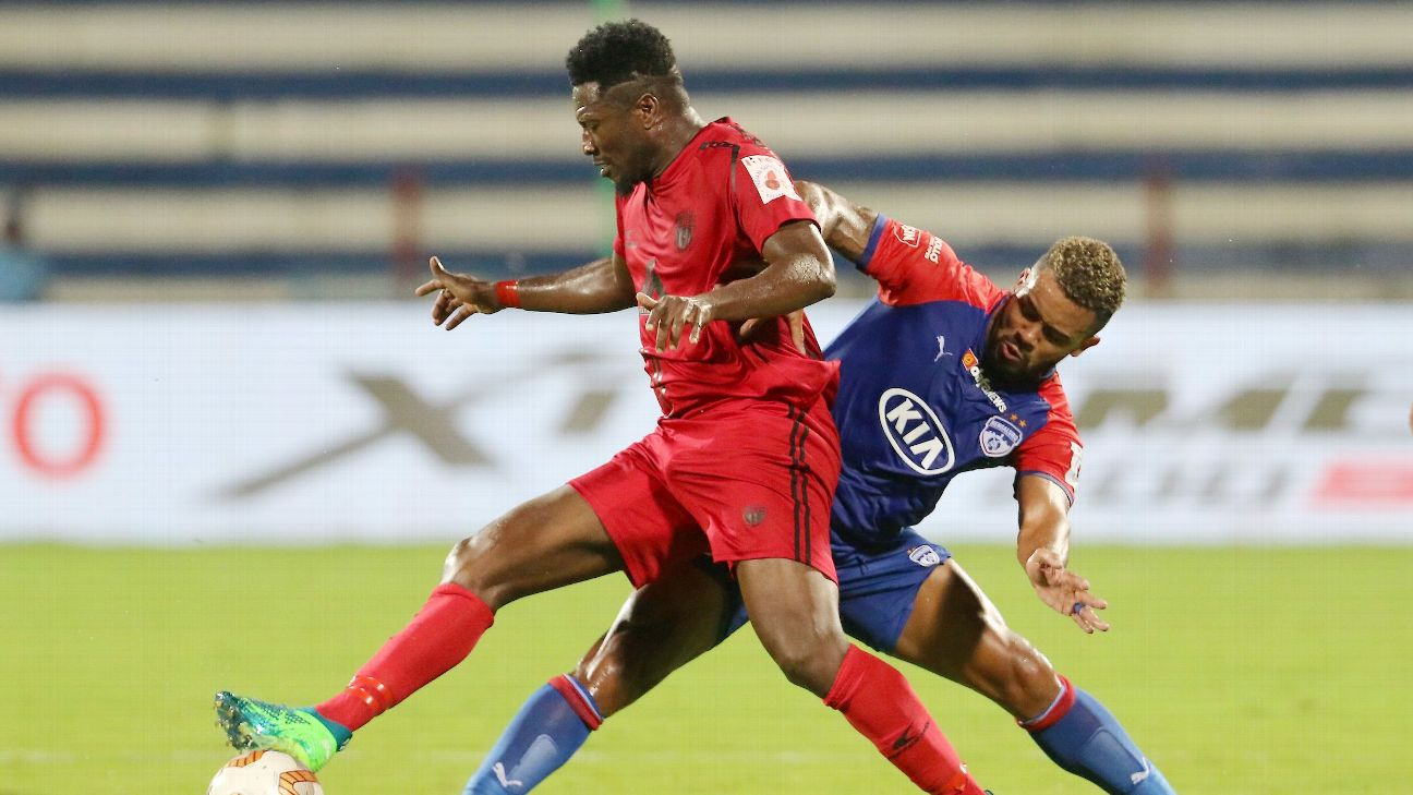 Asamoah Gyan of Northeast United FC and Raphael Augusto of Bengaluru FC compete for the ball.