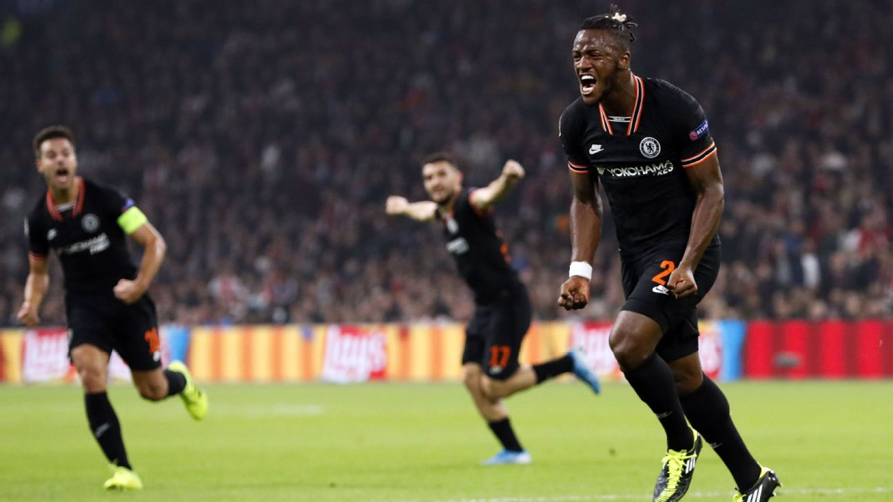 Michy Batshuayi celebrates after scoring in Chelsea's Champions League win at Ajax.