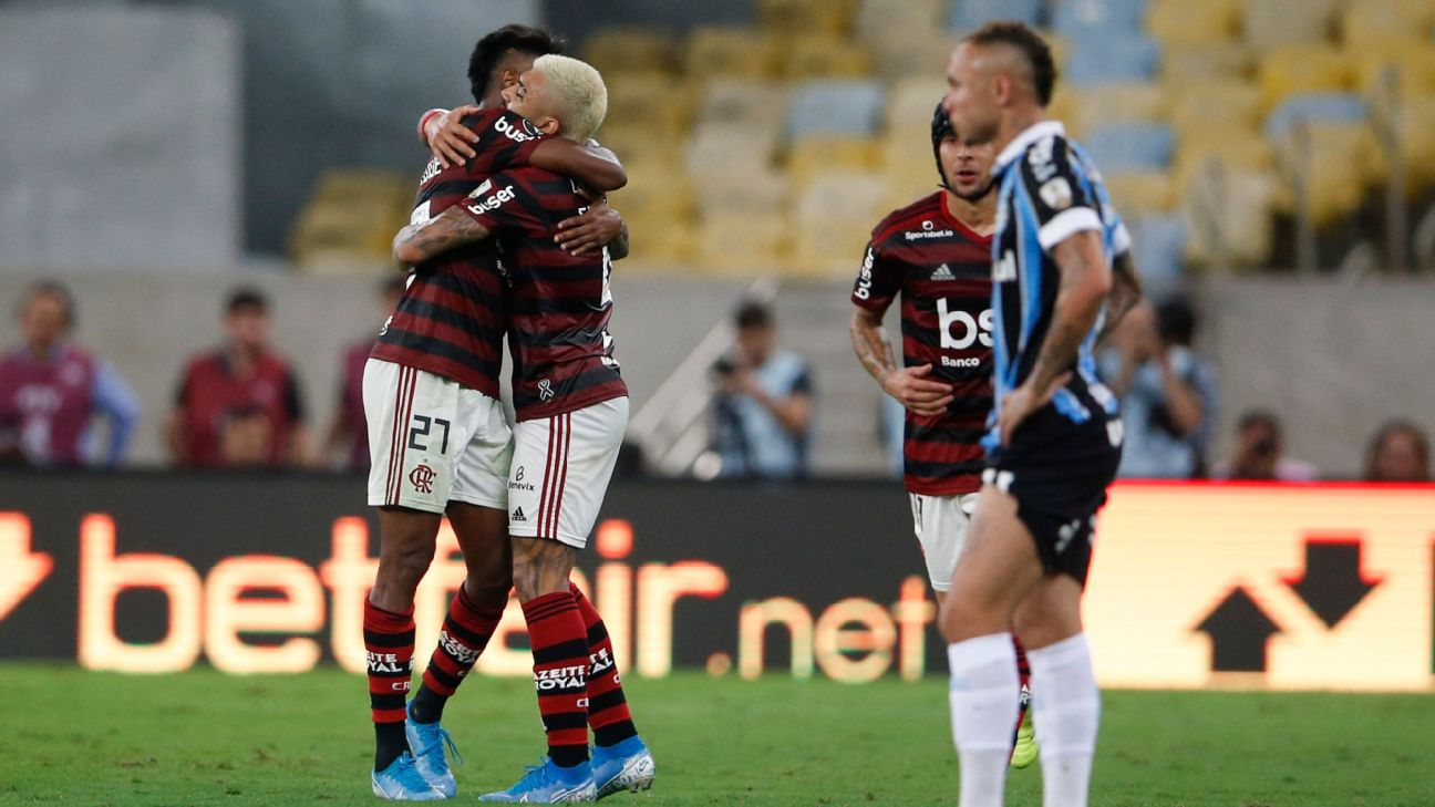 Bruno Henrique of Brazil's Flamengo, left, embraces teammate Gabriel after scoring a goal against Gremio.