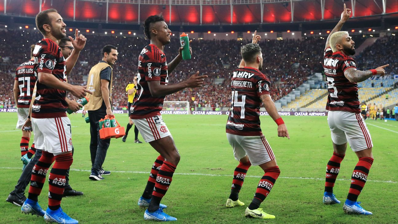 Gabriel Barbosa of Flamengo celebrates with teammates after scoring a goal against Gremio.