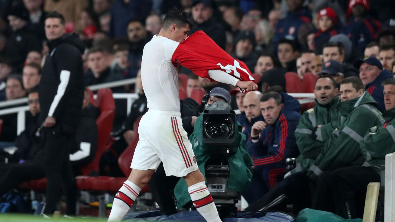Granit Xhaka of Arsenal leaves the pitch after being substituted off