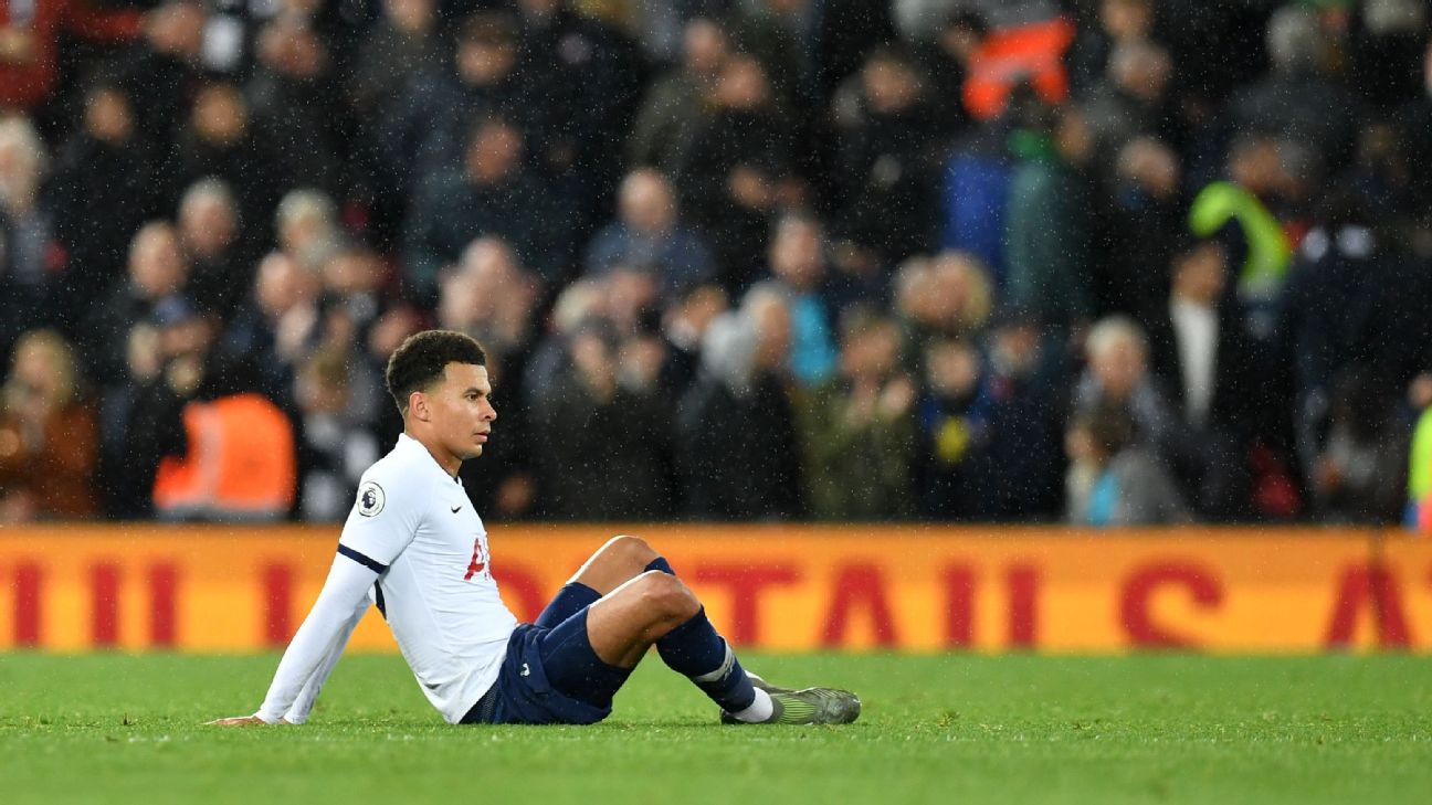 Dele Alli looks on after Tottenham's Premier League loss to Liverpool.