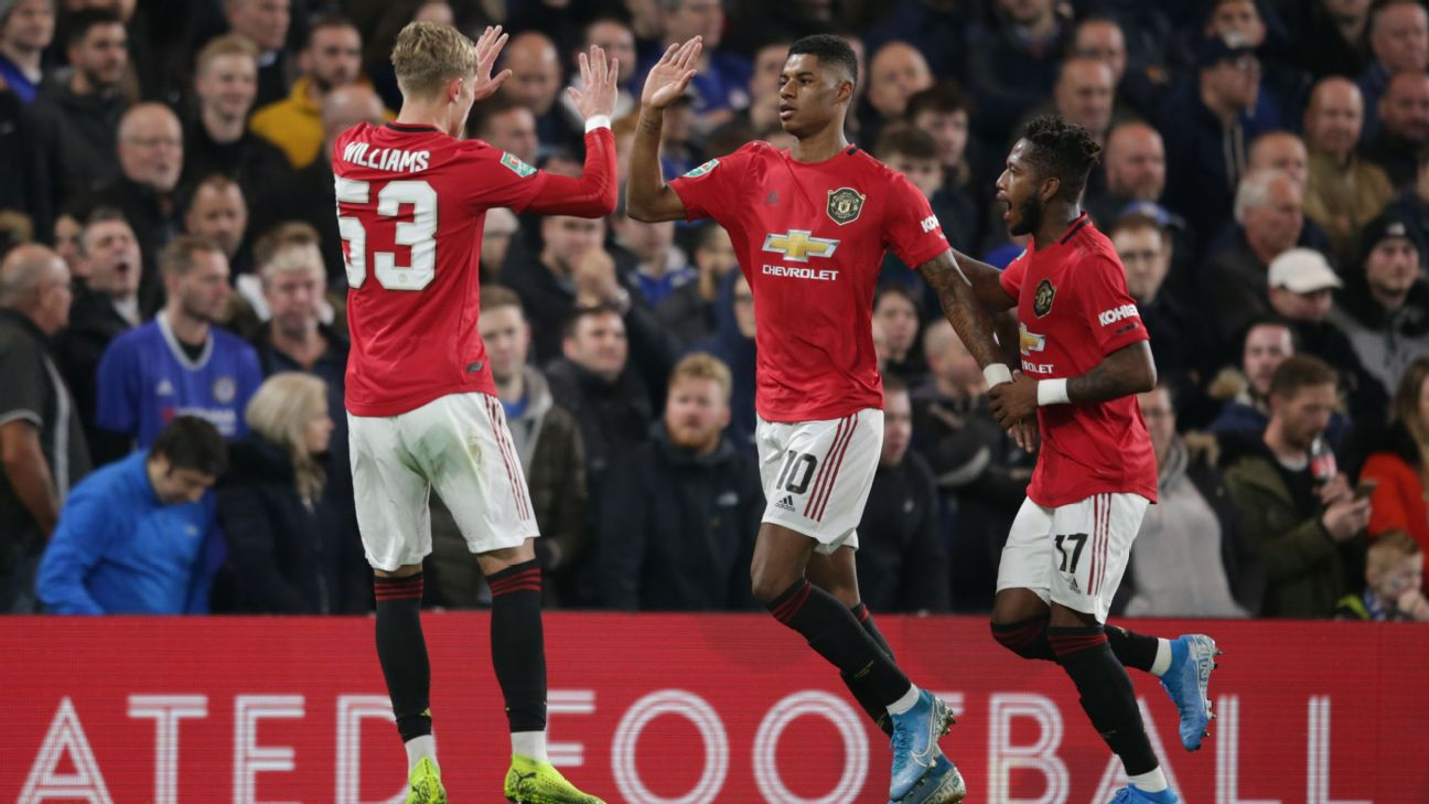 Marcus Rashford, centre, celebrates after scoring a goal for Man United against Chelsea.