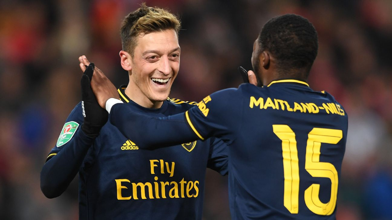 Mesut Ozil celebrates Arsenal's 4th goal with goalscorer Ainsley Maitland-Niles