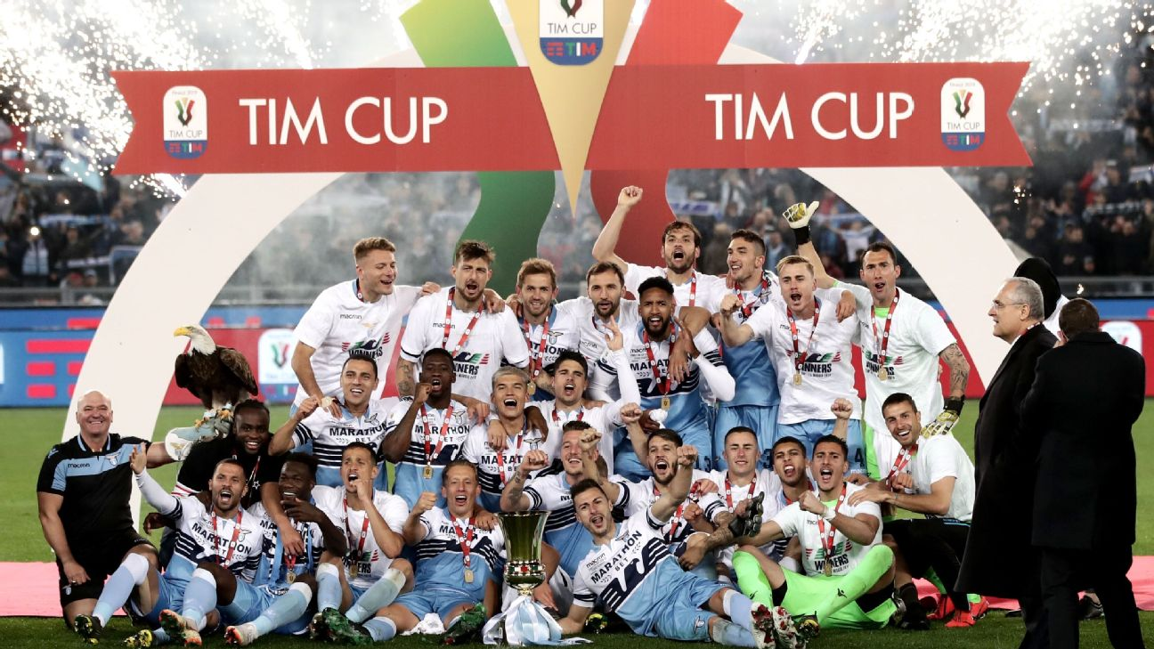 Lazio's team players and members of staff celebrate with their eagle mascot and the Tim Cup