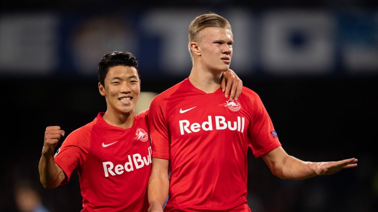Erling Braut Haaland of Salzburg, right, celebrates after scoring a goal against Napoli in the Champions League.