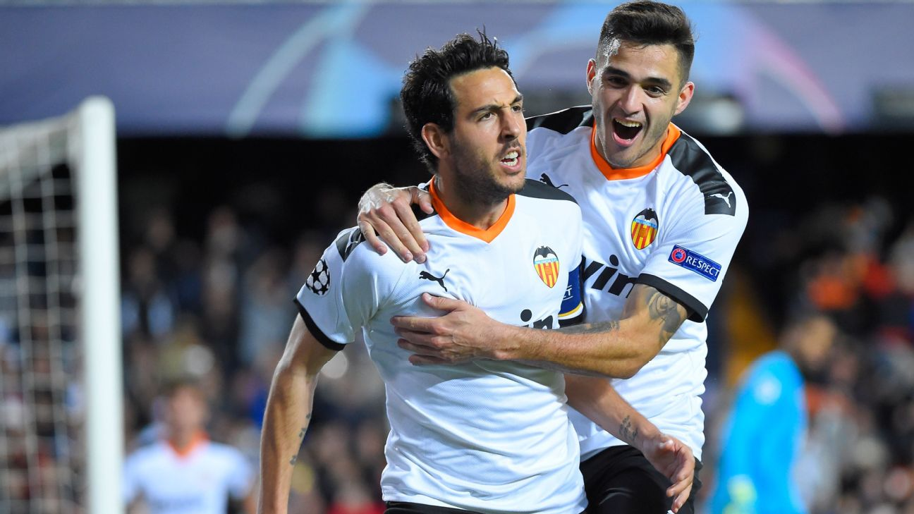 Valencia's Daniel Parejo, left, celebrates after scoring a goal against Lille in the Champions League.