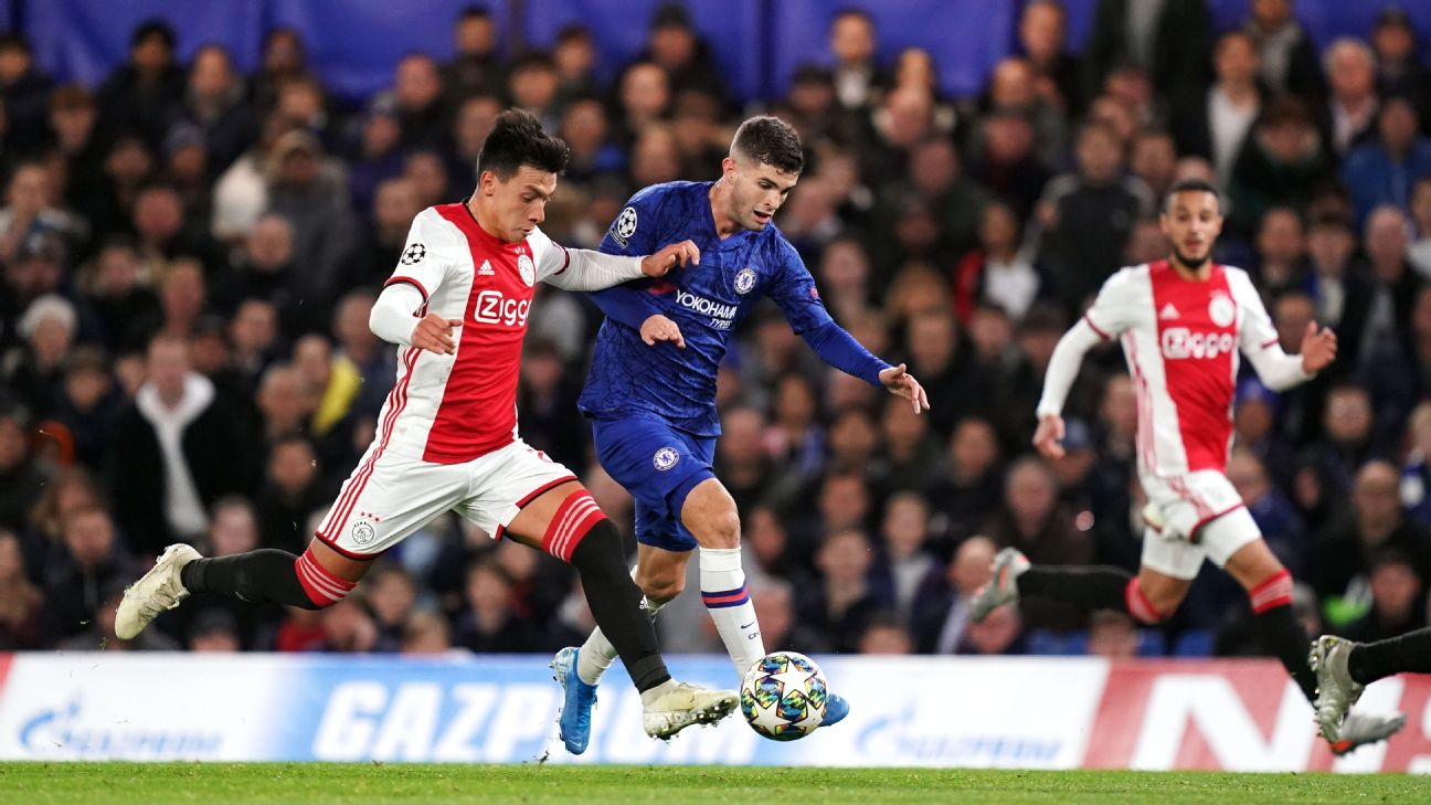 Christian Pulisic battles for the ball with Lisandro Martinez in Chelsea's match against Ajax.