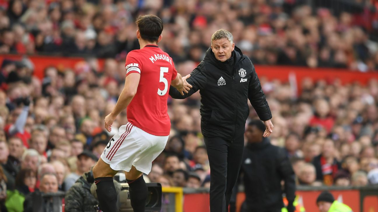 Man United manager Ole Gunnar Solskjaer congratulates Harry Maguire as he leaves the pitch.