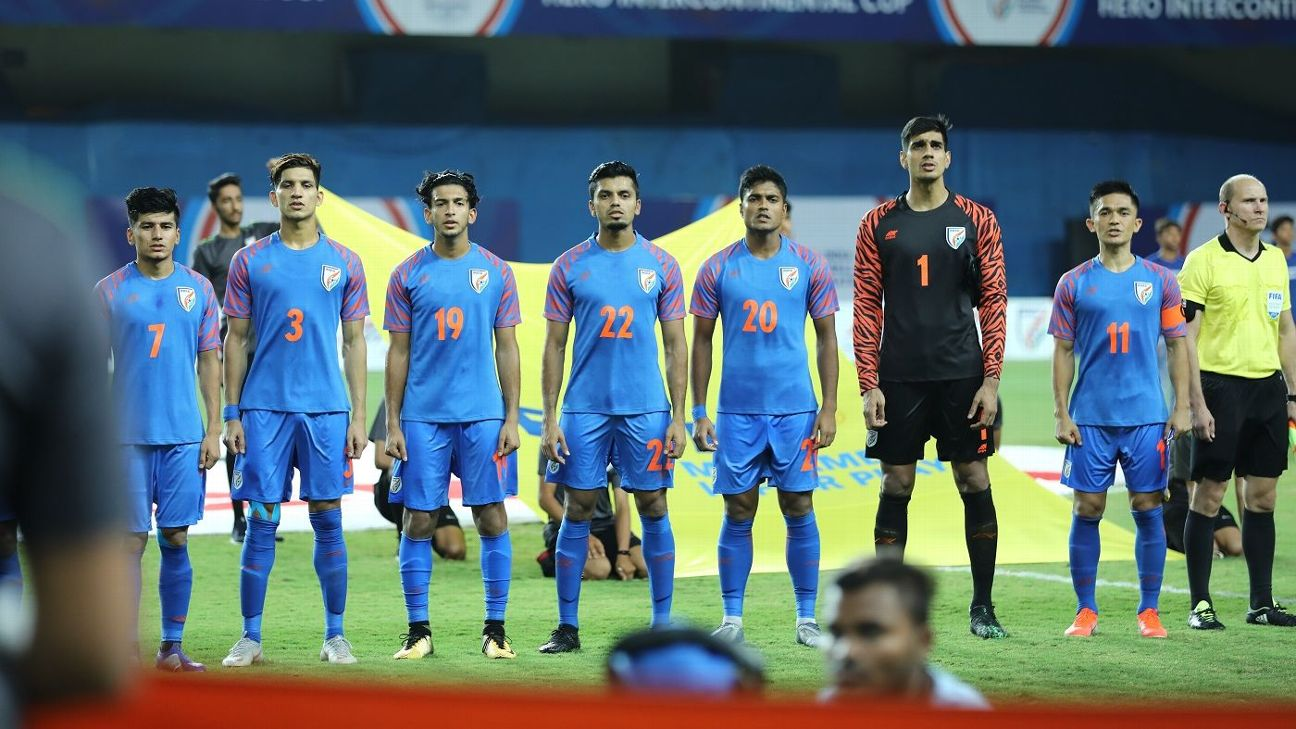 The Indian football team lines up for the national anthem ahead of a game.