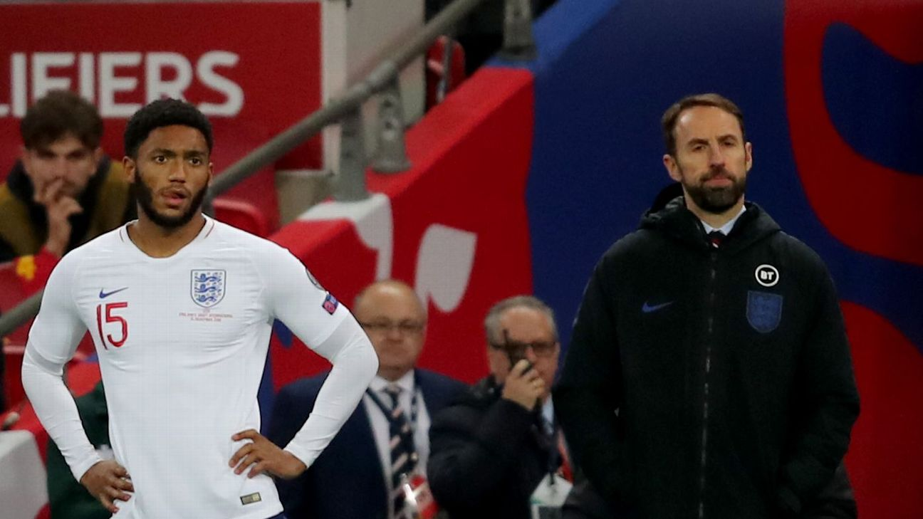 Joe Gomez, left, waits to take the field during England's match against Montenegro on Thursday.