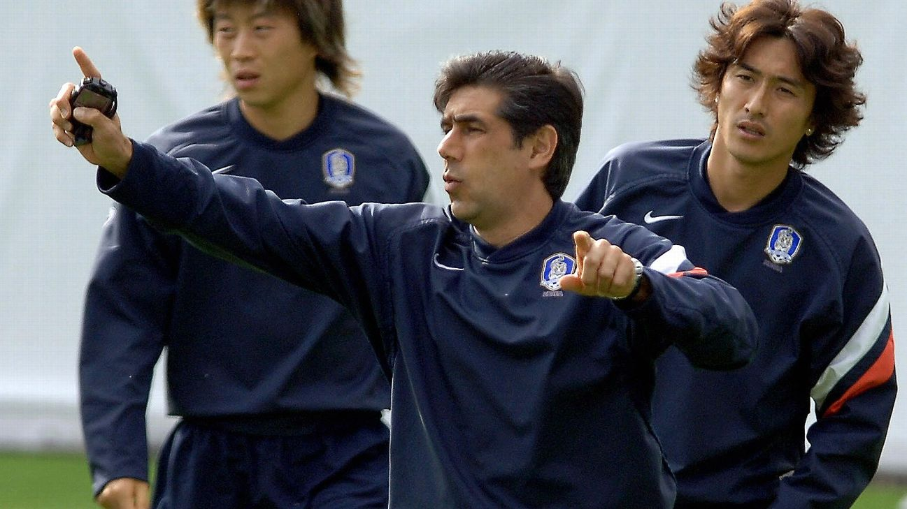Assistant coach Afshin Ghotbi instructs South Korea during a training session.