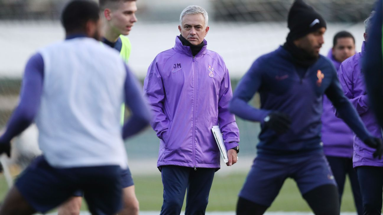 Jose Mourinho looks on during his first training session in charge of Tottenham.