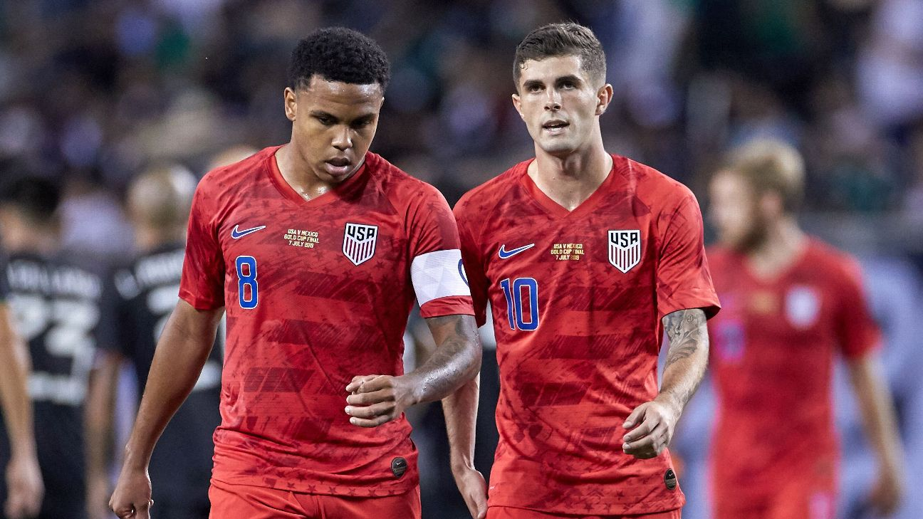 Weston McKennie and Christian Pulisic look on during the U.S.'s Gold Cup final loss to Mexico.