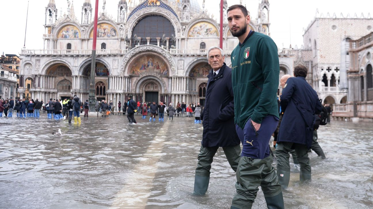 Gianluigi Donnarumma walks in St. Mark's Square following Venice suffered severe flooding.