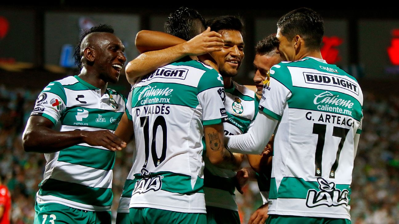 Santos players celebrate during their Liga MX match against Veracruz.