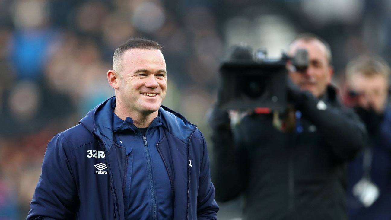 Derby County player-manager Wayne Rooney is unveiled on the pitch before his team's match with QPR.