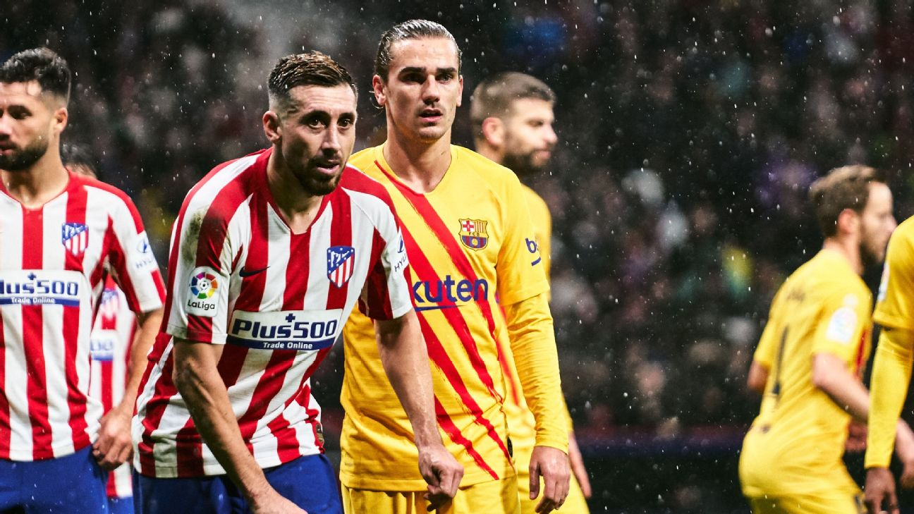Hector Herrera and Antoine Griezmann look on during the La Liga match between Atletico Madrid and Barcelona.