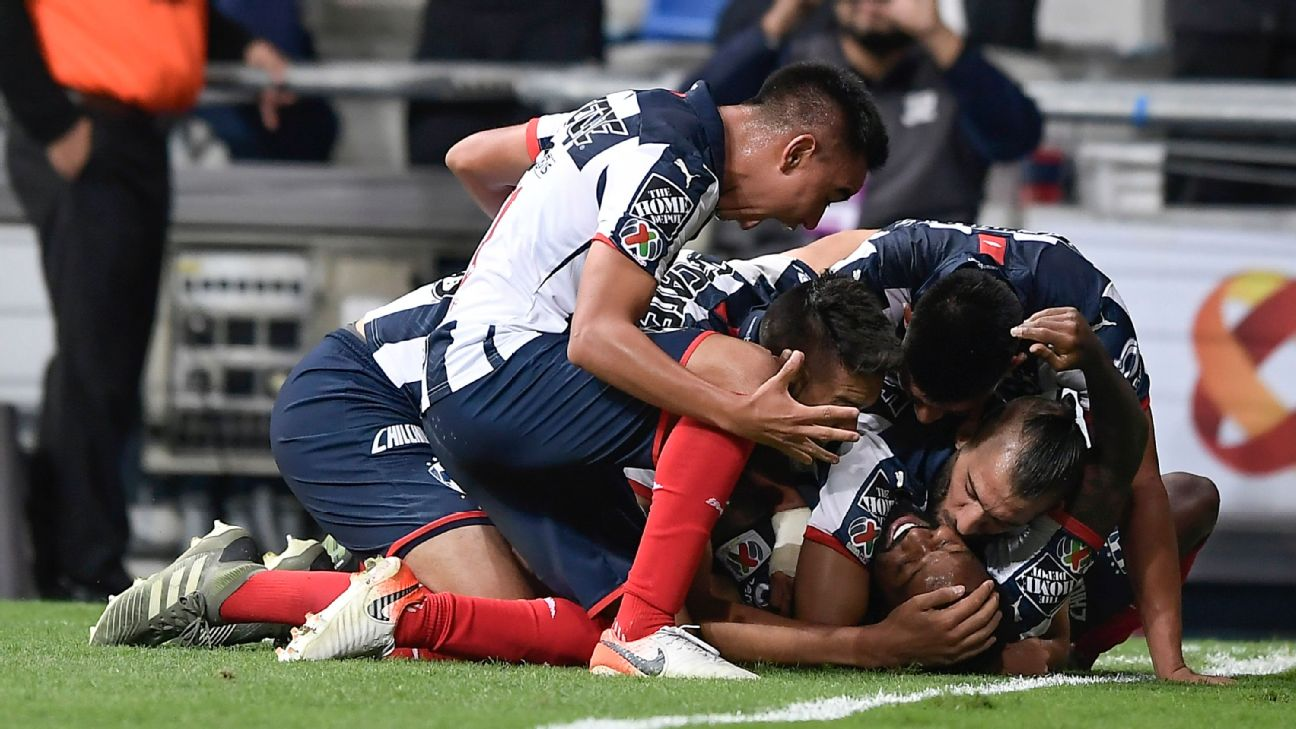Monterrey players celebrate during their Liga MX playoff match against Santos Laguna.