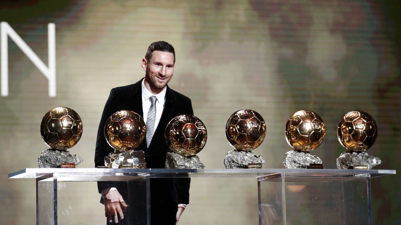 Lionel Messi poses with his six Ballon d'Or awards after winning again in 2019.
