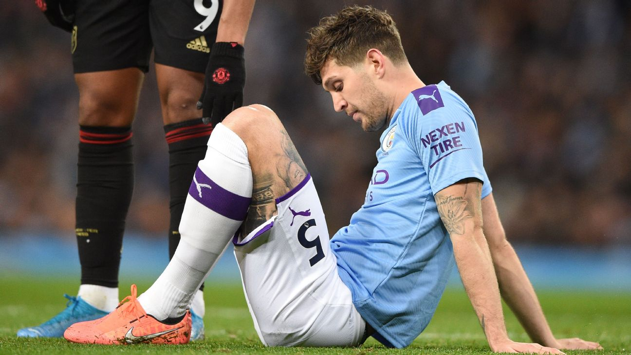 John Stones looks on during Manchester City's Premier League loss to Manchester United.
