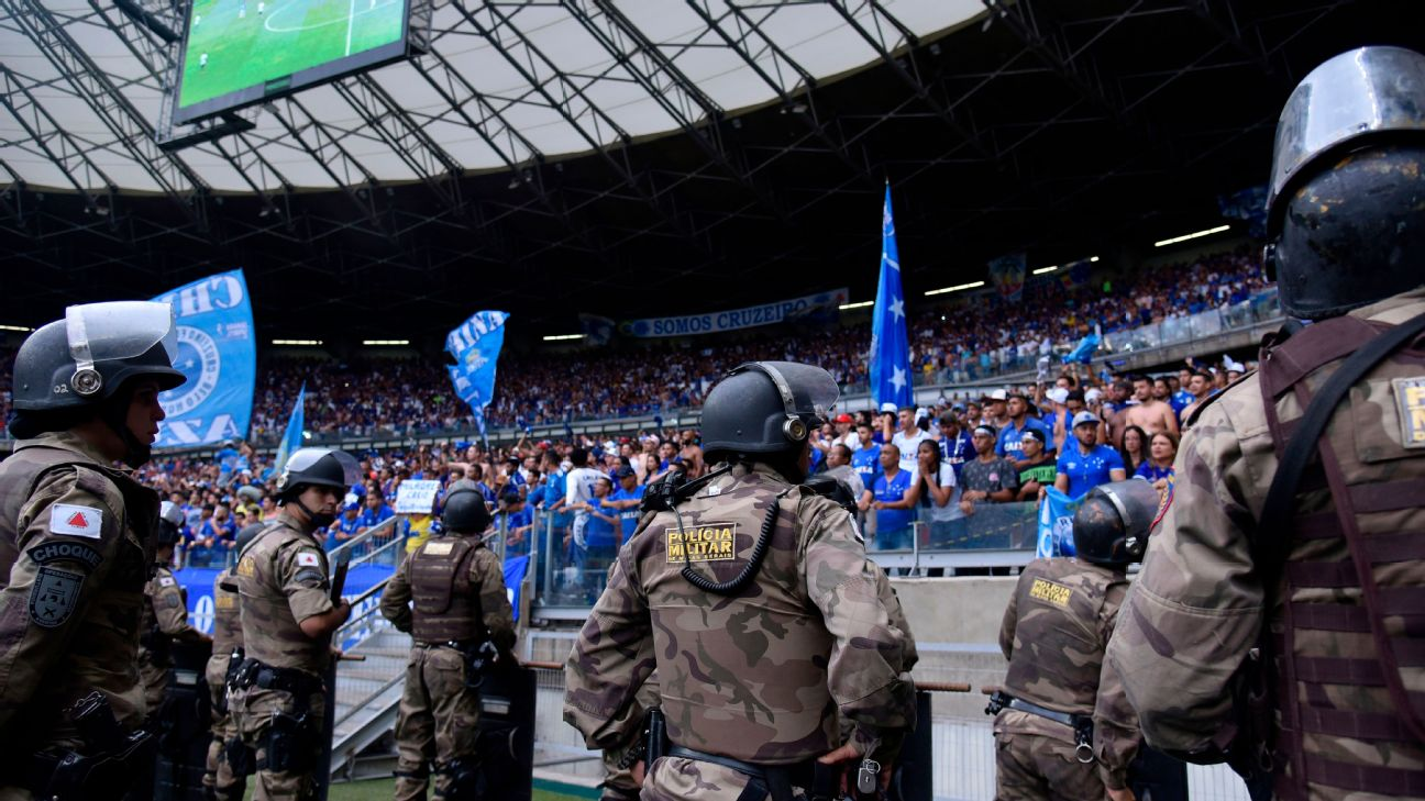 Riot police stand by facing supporters of Cruzeiro during during the Brazilian Championship football match against Palmeiras.
