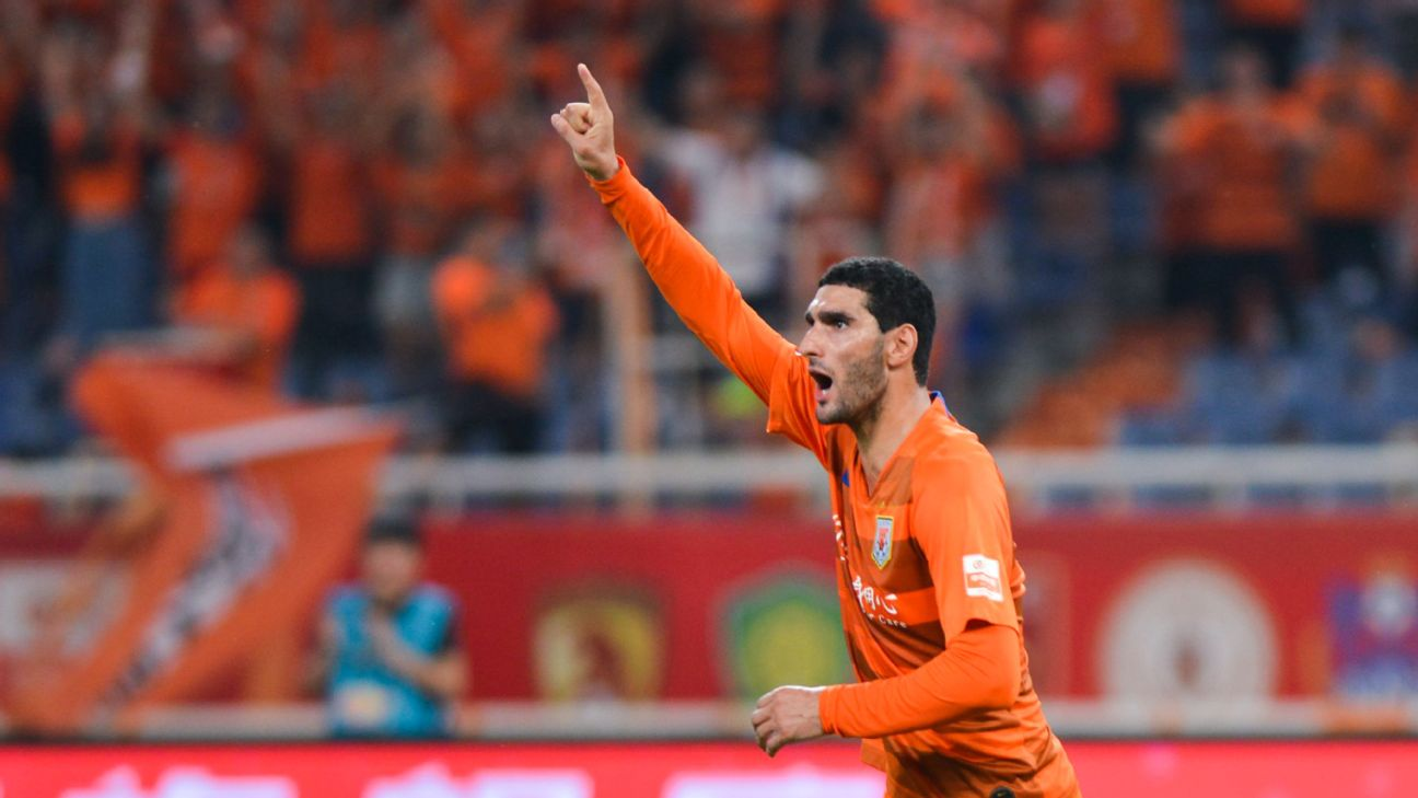 Marouane Fellaini of Shandong Luneng celebrates after scoring a goal in the Chinese Super League.