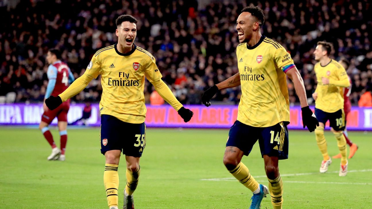 Gabriel Martinelli and Pierre-Emerick Aubameyang celebrate during Arsenal's Premier League win at West Ham.