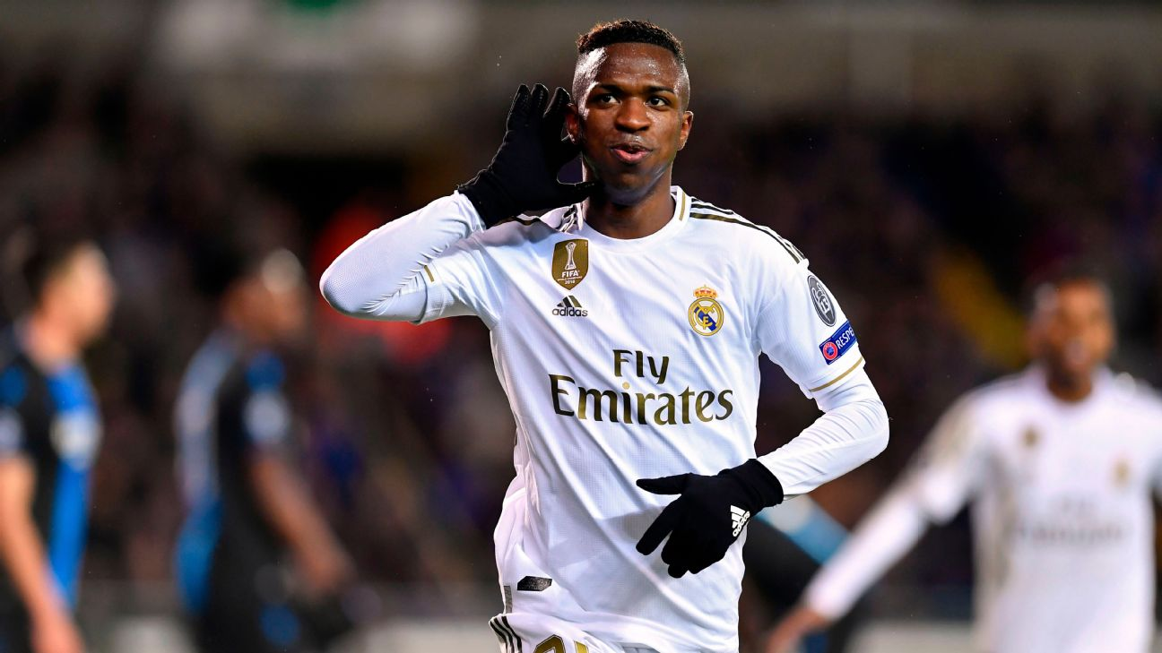 Vinicius celebrates after scoring in Real Madrid's Champions League match against Brugge.
