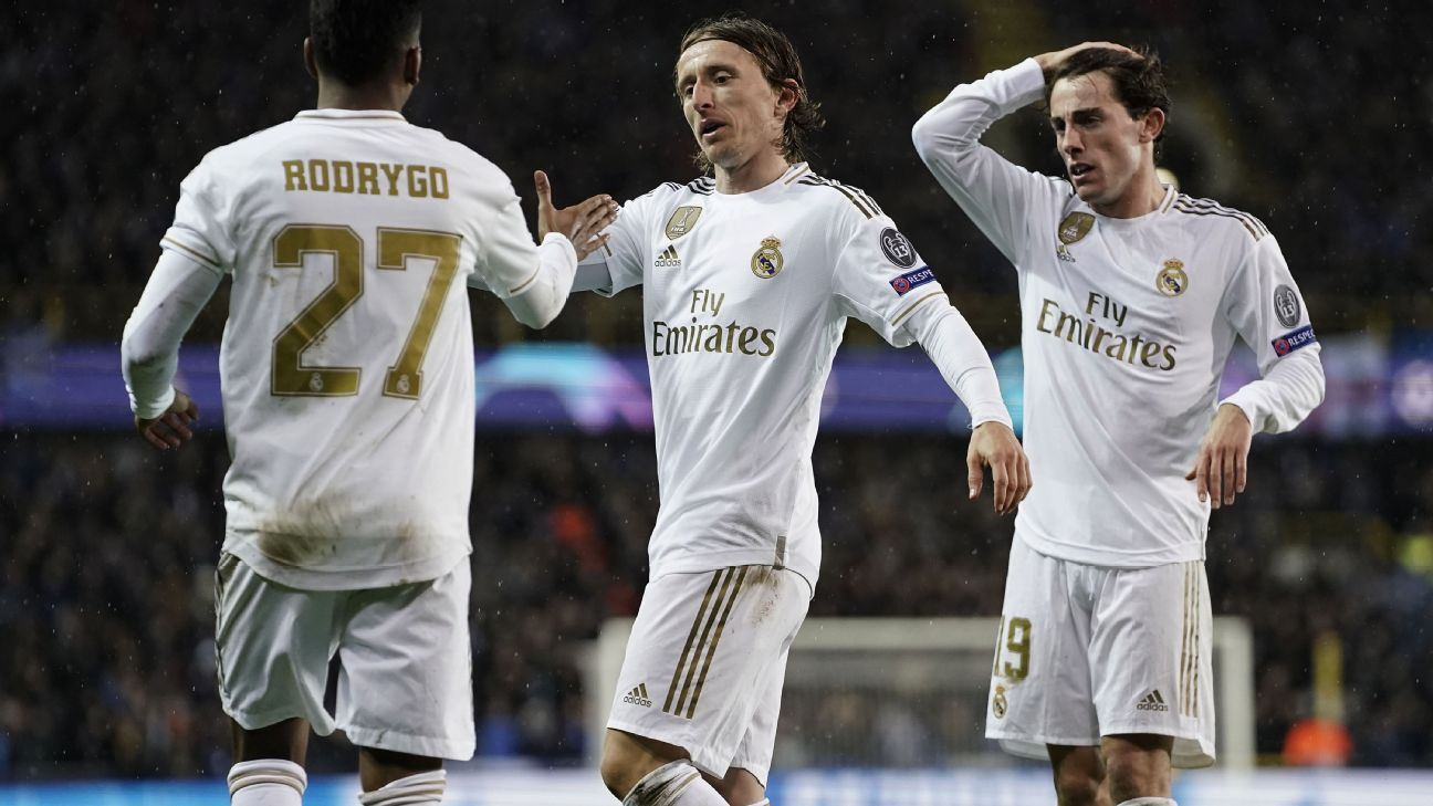 Luka Modric celebrates after scoring in Real Madrid's Champions League win over Brugge.