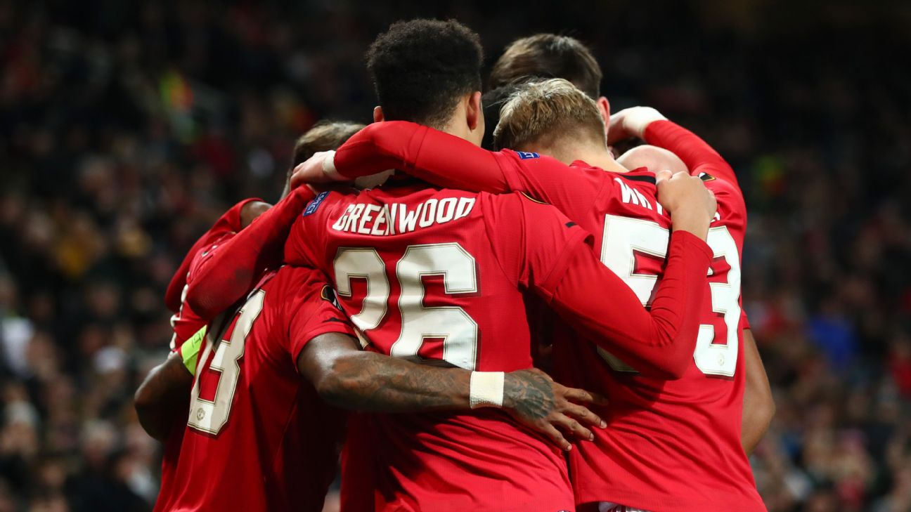 Manchester United players celebrate during their Europa League match against AZ Alkmaar.