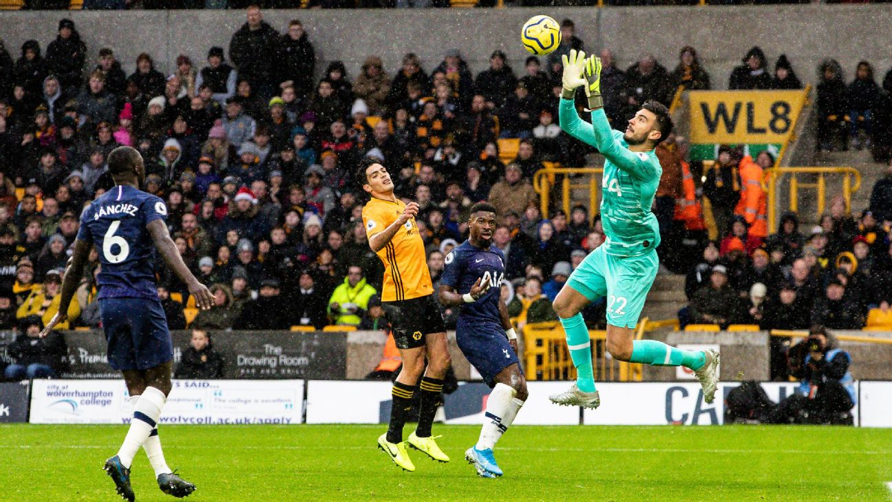 Tottenham goalkeeper Paulo Gazzaniga makes a save against Wolverhampton.