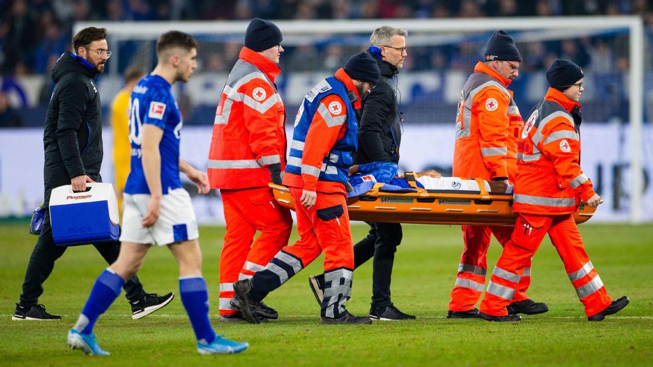 Schalke midfielder Weston McKennie is stretchered off the field after picking an injury against Frankfurt.