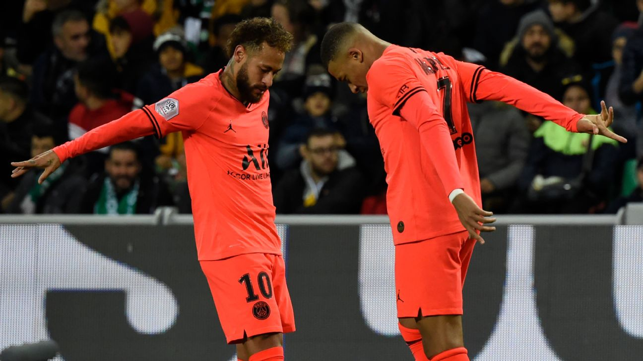 PSG's Kylian Mbappe, right, celebrates with teammate Neymar after scoring a goal against St Etienne.
