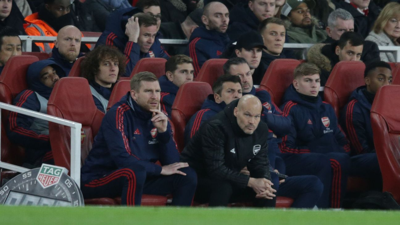 Arsenal manager Freddie Ljungberg, centre, looks on during his team's loss to Man City.