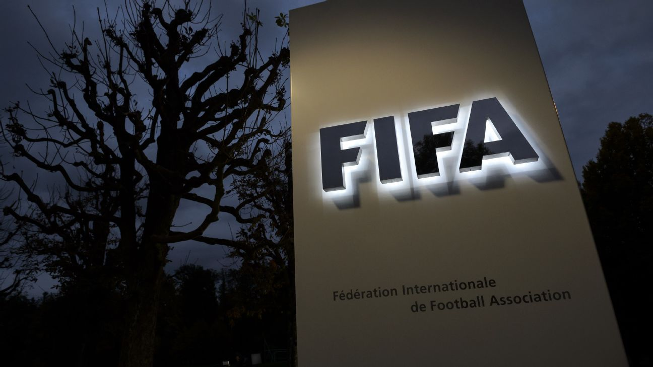 This photo taken on October 8, 2015 in Zurich shows the entrance sign with the logo at the FIFA world headquarters
