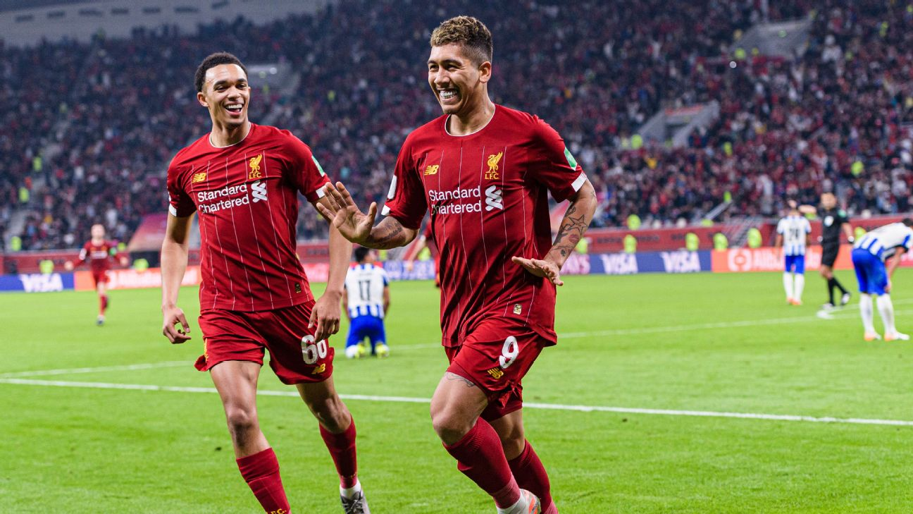 Roberto Firmino and Trent Alexander-Arnold celebrate during Liverpool's Club World Cup win over Monterrey.