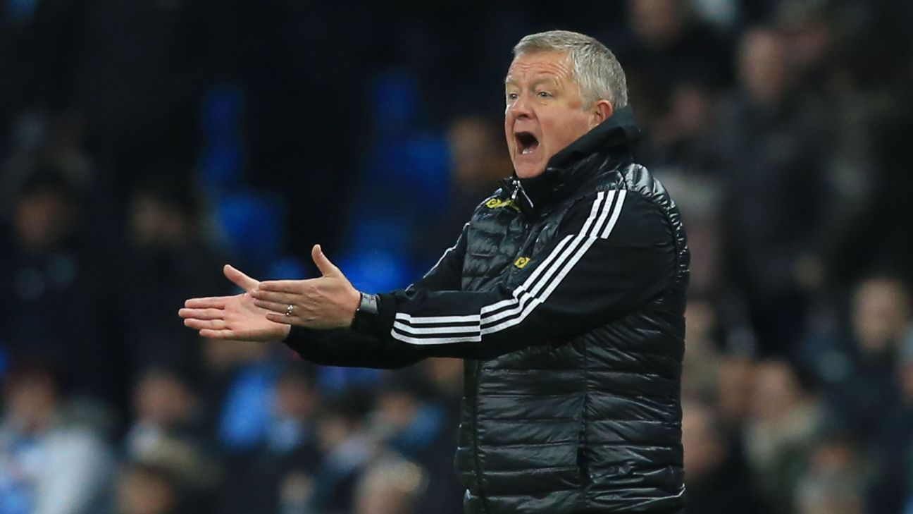 Sheffield United manager Chris Wilder gestures to his players during their match against Manchester City.