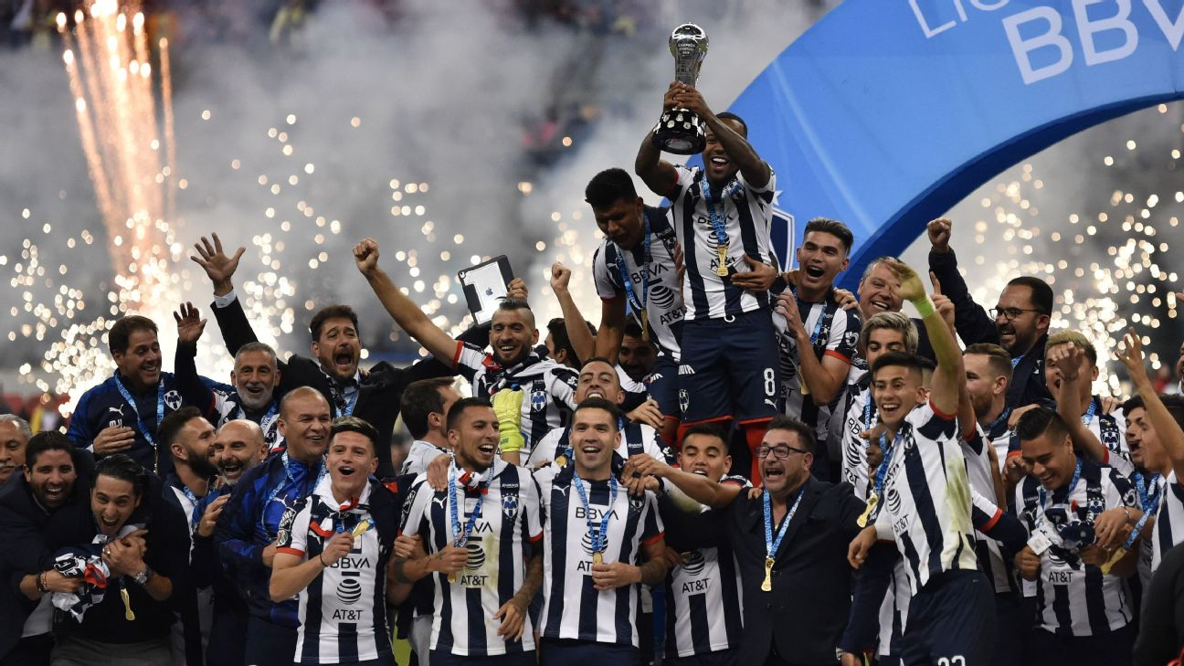 Dorlan Pabon lifts the trophy following Monterrey's Liga MX Apertura final win over Club America.