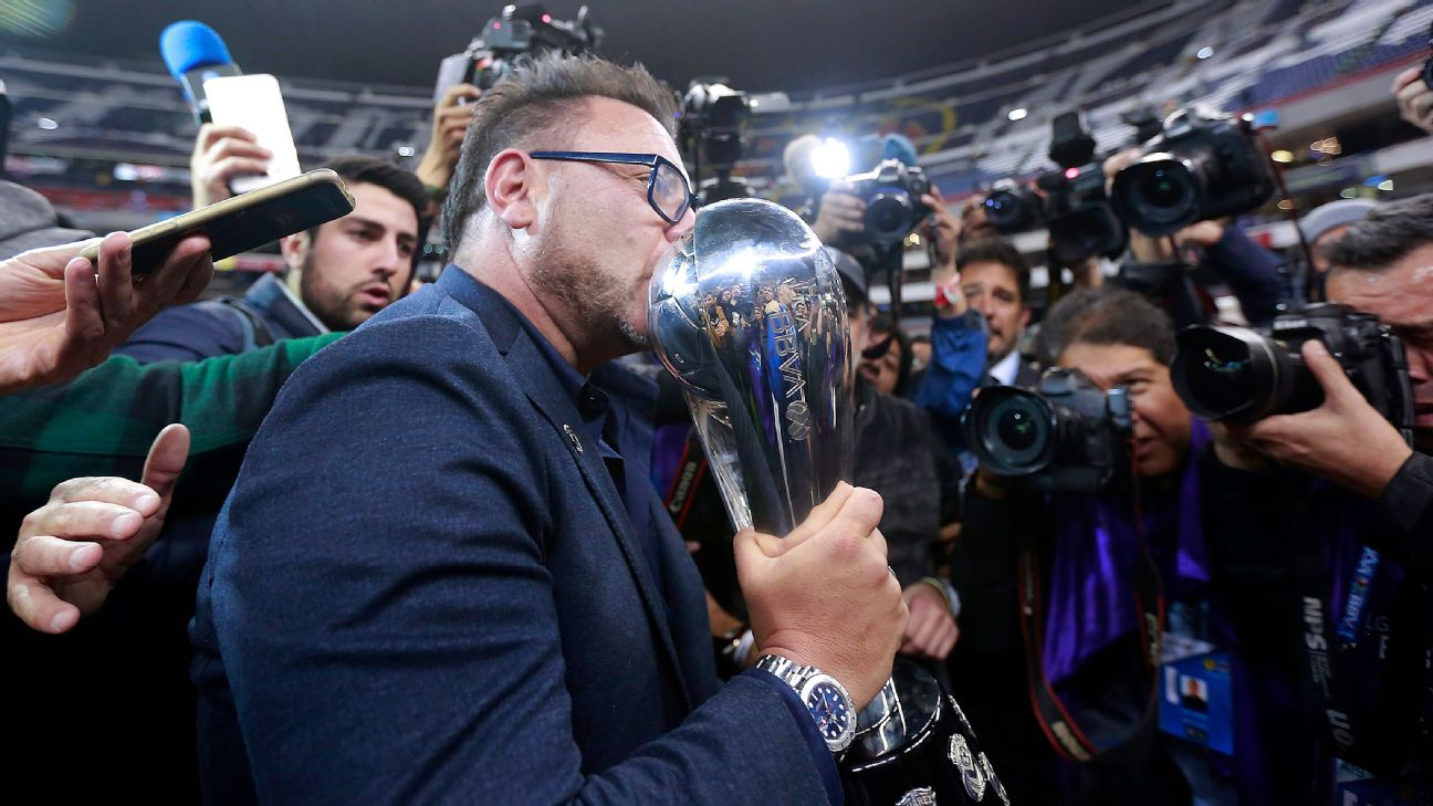 Antonio Mohamed kisses the trophy after his Monterrey beat America in the Liga MX Apertura final.