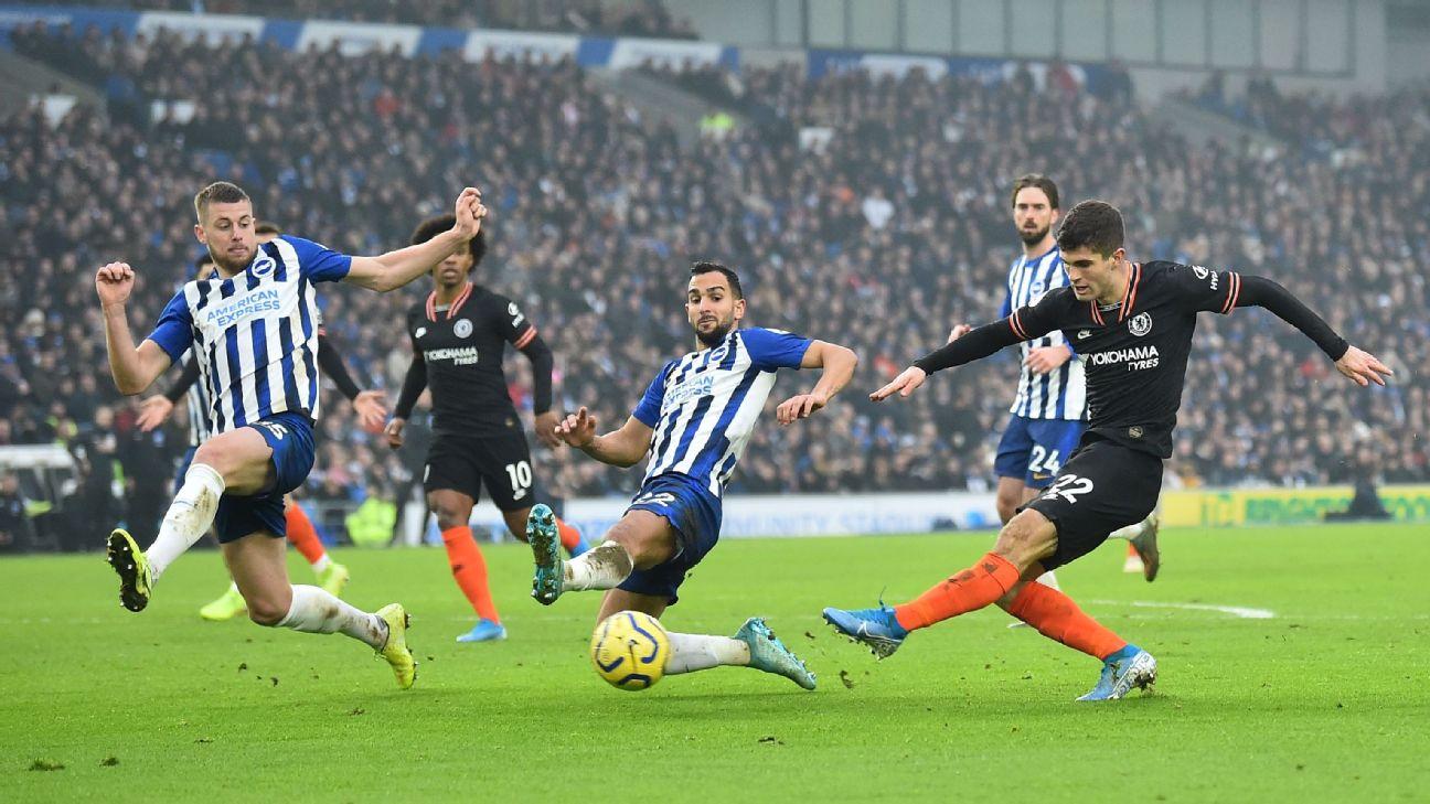 Chelsea's US midfielder Christian Pulisic (R) has a shot on goal