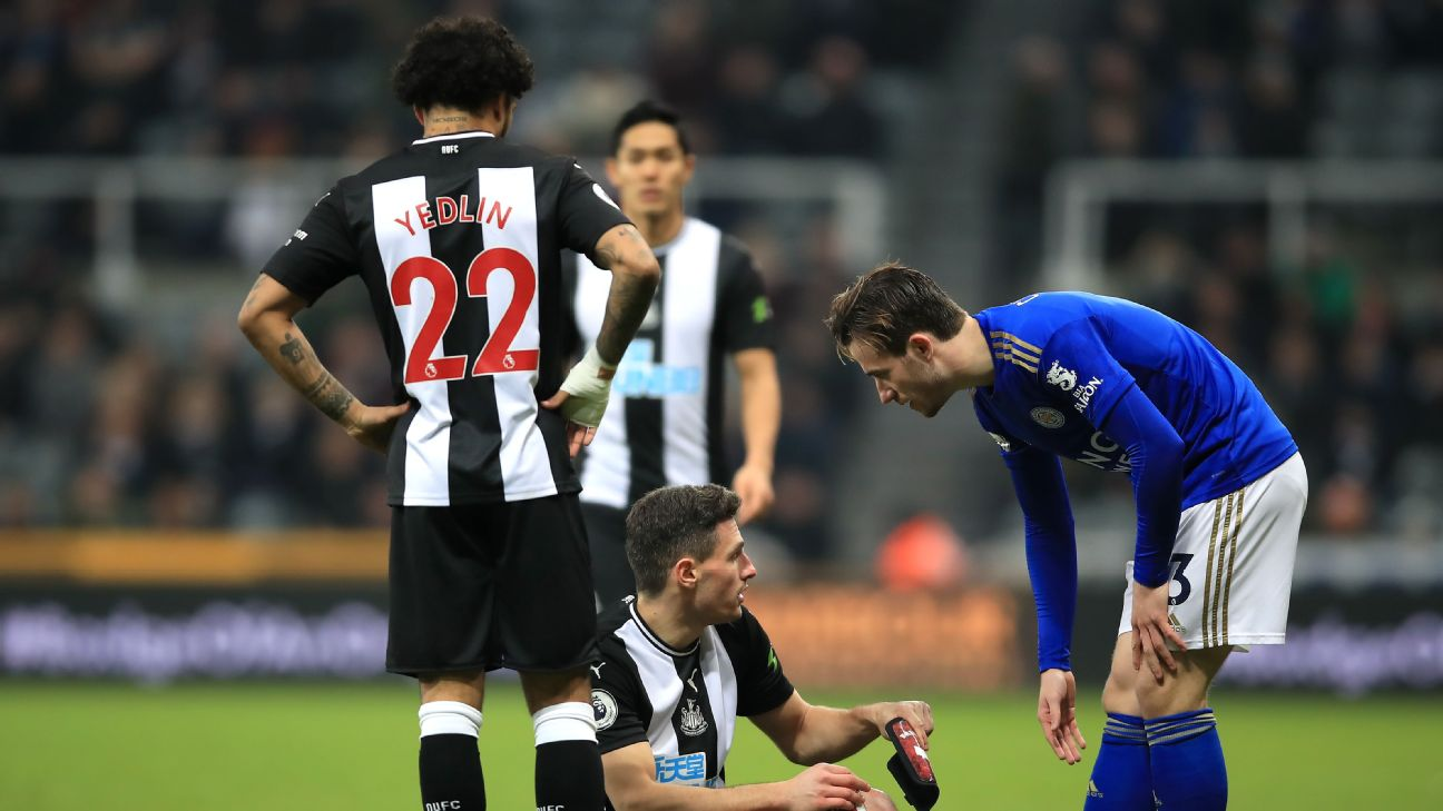 Deandre Yedlin looks on after his Newcastle teammate Fabian Schar appeared to have picked up an injury.
