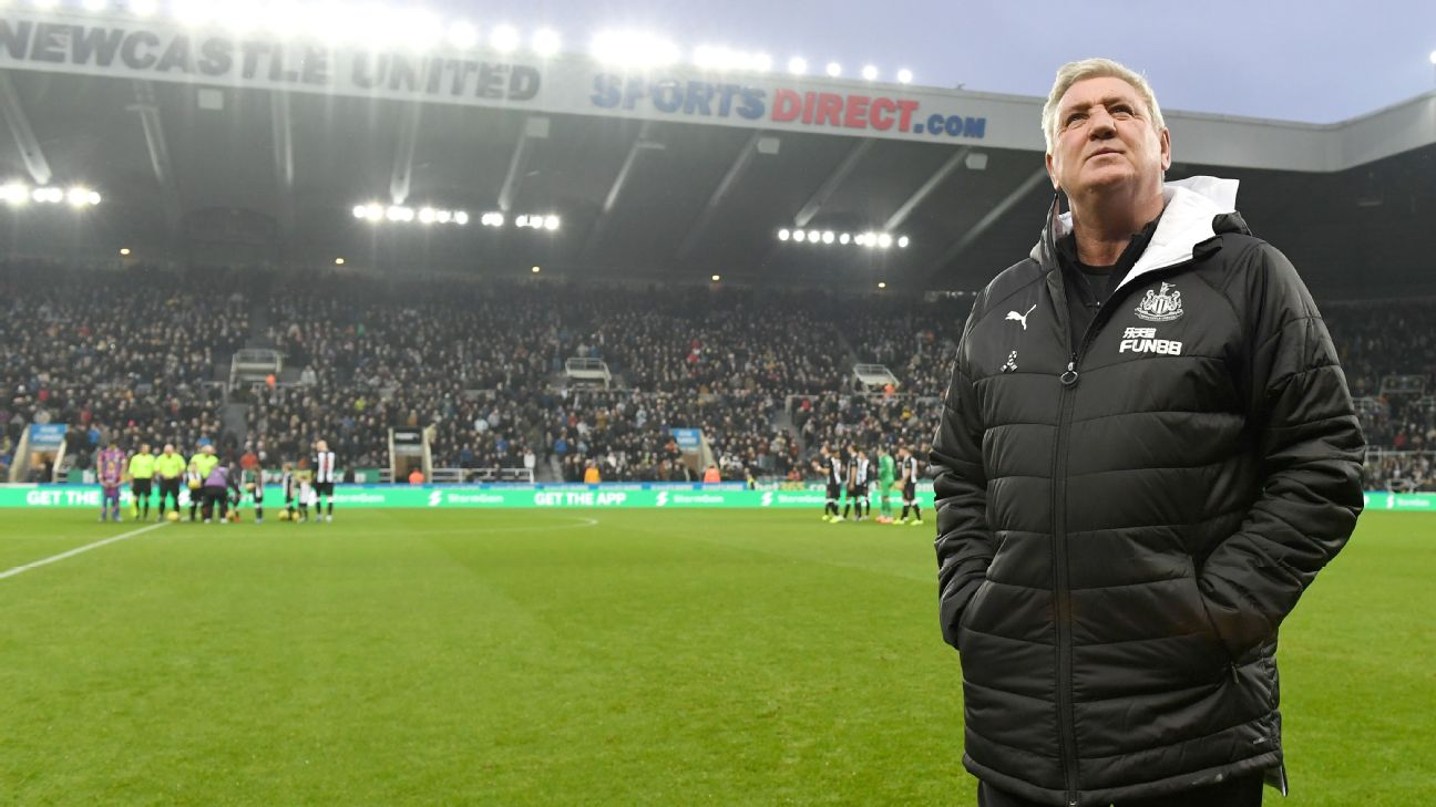Steve Bruce, Manager of Newcastle United looks on