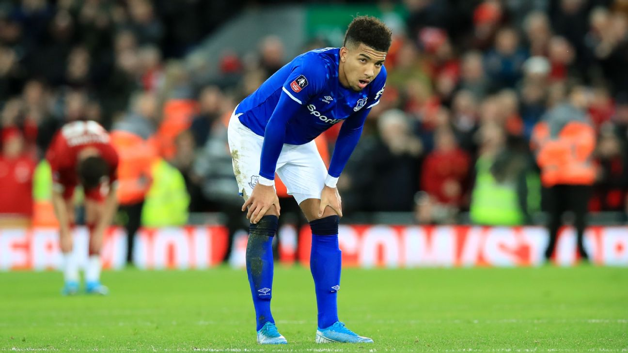 Mason Holgate looks on after Everton's FA Cup defeat at Liverpool.