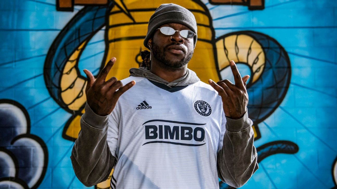 Jay Ajayi poses for a photo after signing to Philadelphia Union's eMLS team.