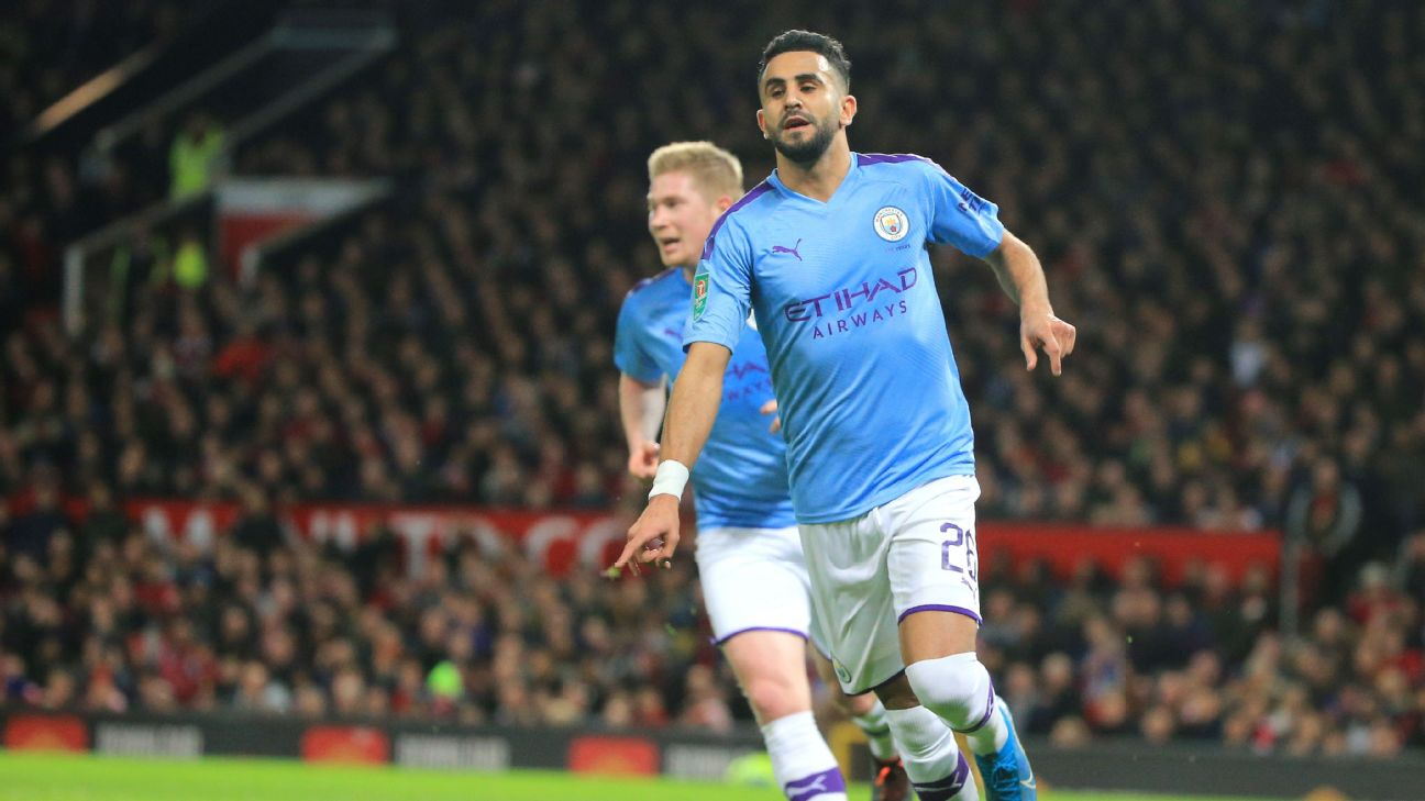 Riyad Mahrez celebrates after scoring in Manchester City's Carabao Cup match at Manchester United.