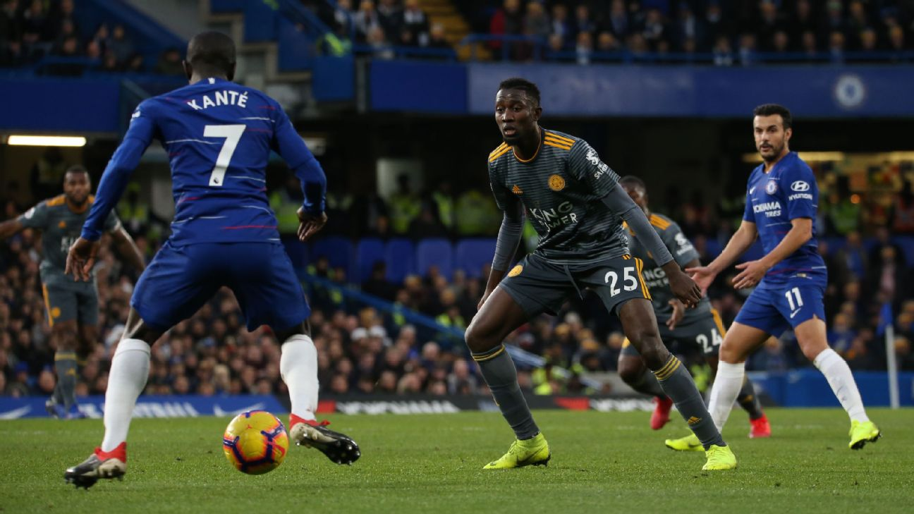Chelsea's N'Golo Kante and Leicester City's Wifred Ndidi battle for the ball