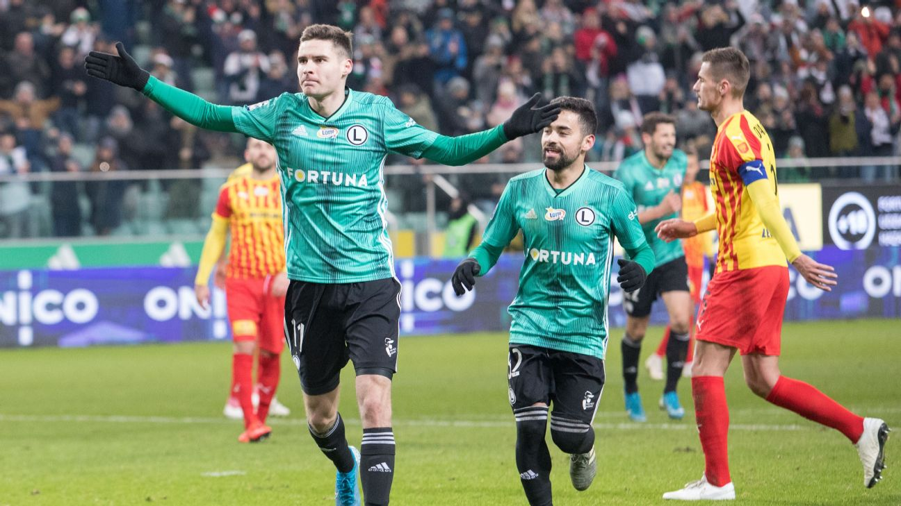 Legia Warsaw's Jaroslaw Niezgoda celebrates after scoring a goal against Korona Kielce.