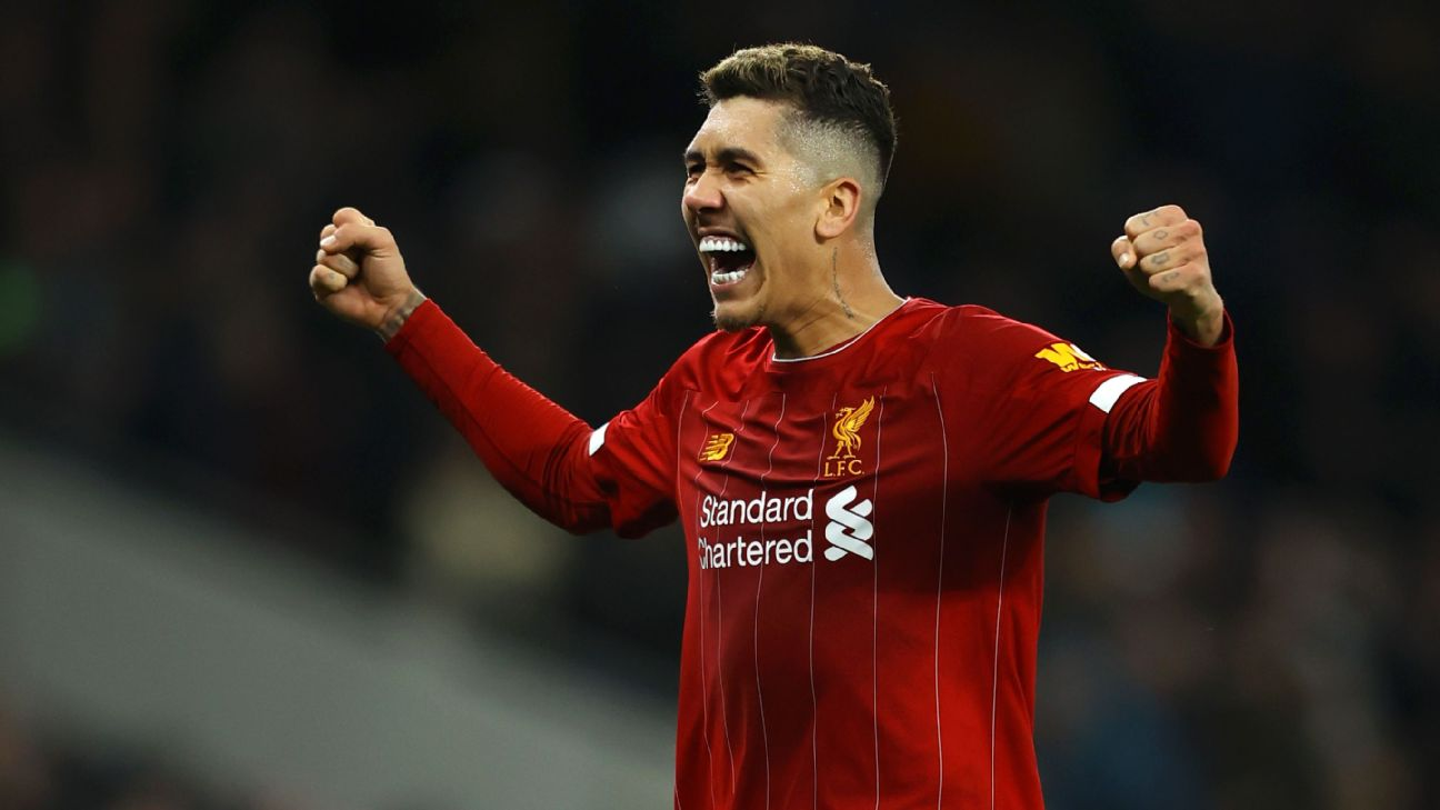 Roberto Firmino celebrates after scoring in Liverpool's Premier League win at Tottenham.