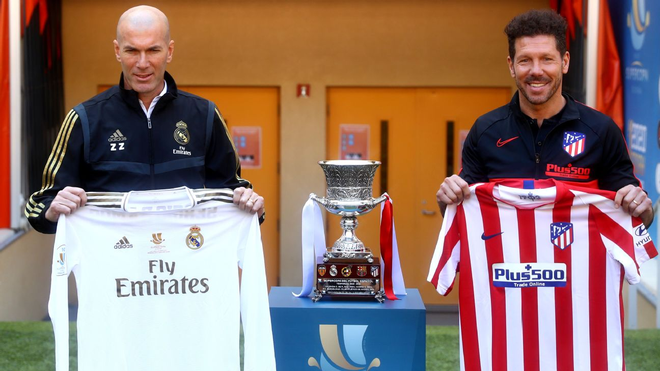 Zinedine Zidane and Diego Simeone pose for photos ahead of the Spanish Supercopa final between Real Madrid and Atletico Madrid.